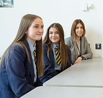 Pupils in science class performing experiment